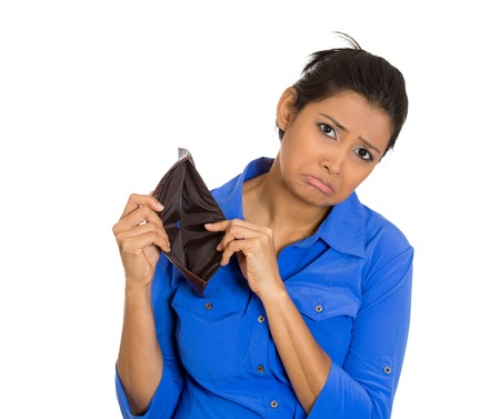 broke: Closeup portrait of shocked, upset, sad, unhappy young woman standing showing empty brown wallet, isolated against white background. Financial difficulties, bad economy concept. Negative emotion