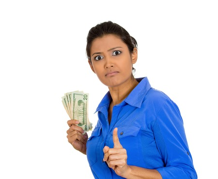 glut: Closeup portrait of greedy young woman corporate business employee, worker, student holding dollar banknotes tightly, isolated on white background. Negative human emotion facial expression feeling