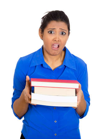 project deadline: Closeup portrait of busy nervous worried young woman carrying tons of books, stressed from project deadline, isolated on white background. Negative emotion facial expression feelings, body language