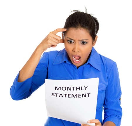 bank records: Closeup portrait of shocked funny looking young woman disgusted at her monthly statement, isolated on white background. Negative human emotions, facial expression, feelings. Financial crisis, bad news