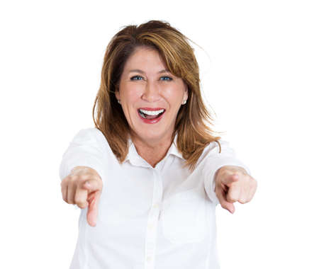 stretched: Closeup portrait of middle-age laughing excited, happy woman pointing at you camera gesture with two arms, isolated on white background. Positive emotion facial expression feelings, body language Stock Photo