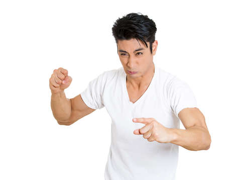 prove: Closeup portrait of angry upset, mad guy, frustrated business man worker employee, hands fist up at you trying to prove his point isolated on white background. Negative human emotion facial expression