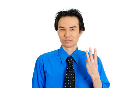 cost estimate: Closeup portrait of young handsome business man, employee, guy giving three fingers sign gesture with hands, isolated on white background. Positive emotion facial expression feeling, signs, symbols
