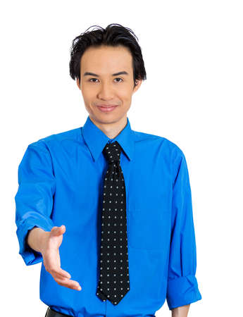pledge: Closeup portrait of handsome young adult smiling man giving extending arm for handshake at camera gesture isolated on white background. Positive emotion facial expression feeling, attitude, perception Stock Photo