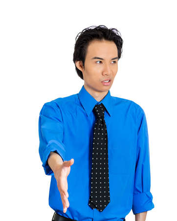 faker: Closeup portrait of sarcastic man with bad attitude extending arm for handshake not happy about it, isolated on white background. Negative emotion facial expression feeling. Politics in corporate life
