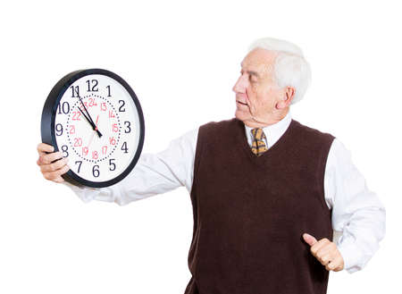 Closeup portrait of old business man, funny looking elderly guy, holding clock, stressed running out, pressured by lack of time, aging, late for meeting isolated on white background. Negative emotions photo