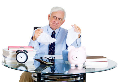Closeup portrait of stressed, overwhelmed, sad elderly business man, accountant, broker, bank worker troubled by budget numbers, unhappy with contract, thinking, worried isolated on white background photo