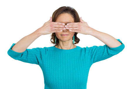 withhold: Closeup portrait of senior mature woman, closing, covering eyes with hands cant look, hiding, avoiding situation, isolated on white background. See no evil concept. Human emotions, facial expressions Stock Photo