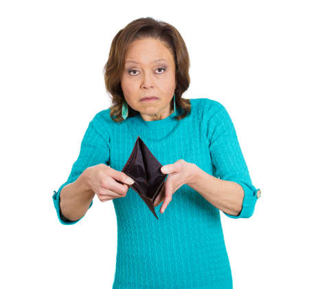 Closeup portrait of senior, old woman surprised, unhappy, puzzled, shocked, holding, showing empty wallet, isolated on white background. Negative emotion, facial expressions, reaction. photo