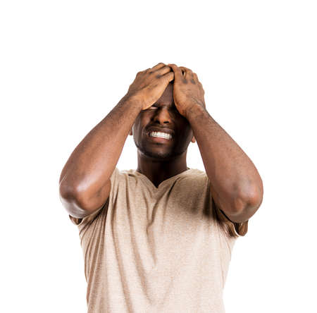 deeply: Closeup portrait of unhappy upset guy, sad thoughtful young business man thinking deeply, bothered by mistakes, hands on head, eyes closed, headache isolated on white background. Negative emotions