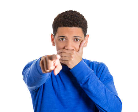 Closeup portrait of young man closed mouth looking shocked, surprised in full disbelief pointing at you camera gesture, isolated on white background. Negative human emotions facial expression feelings Stock Photo - 25999797
