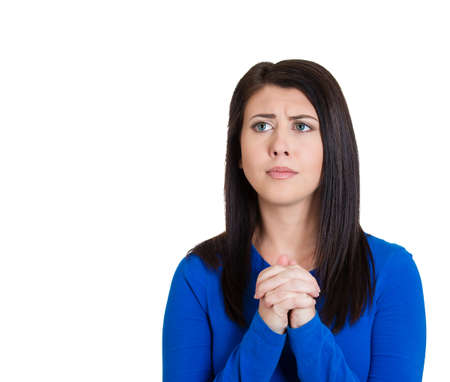 Closeup portrait of sad, troubled young woman who prays, hopes, asks begs for best, going through tough times in her life, isolated on white background. Positive emotions, facial expressions, feeling photo