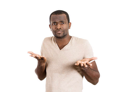 Closeup portrait of dumb clueless young man, arms out asking why what's the problem who cares so what, I don't know. Isolated on white background. Negative human emotion facial expression feelings Stock Photo - 26403082
