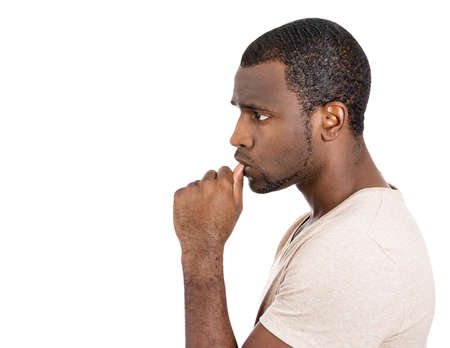 Closeup side view portrait of man, student with finger in mouth, sucking thumb, biting fingernail in stress, deep thought, isolated on white background. Negative emotion, facial expression, feelings Stock Photo - 26403087
