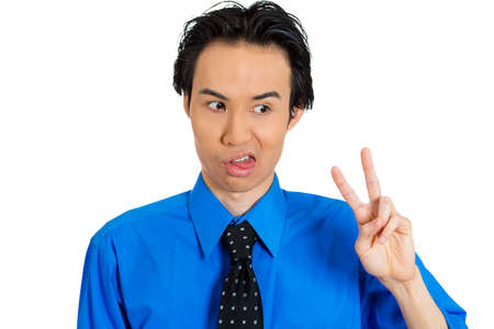 faker: Closeup portrait of annoyed young business man, student, worker, employee, holding up victory, peace sign or two sign, tired of long negotiations, isolated on white background. Human face expressions