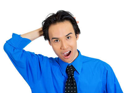 Closeup portrait of handsome, surprised, shocked, stunned young man, worker, employee, in full disbelief hand on head, isolated white background. Human face expressions, emotions, reaction, perception photo