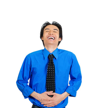 doubled: Closeup portrait of successful young, mirthful business man, employee, doubled over laughing, isolated on white background. Positive human emotions facial expressions, feelings, attitude perception