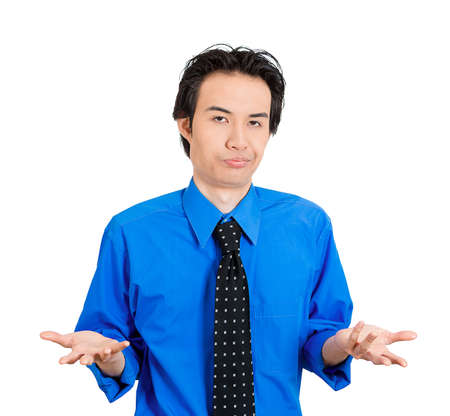 insensitive: Closeup portrait of dumb clueless young man, arms out asking why whats the problem who cares so what, I dont know. Isolated on white background. Negative human emotion facial expression feelings Stock Photo