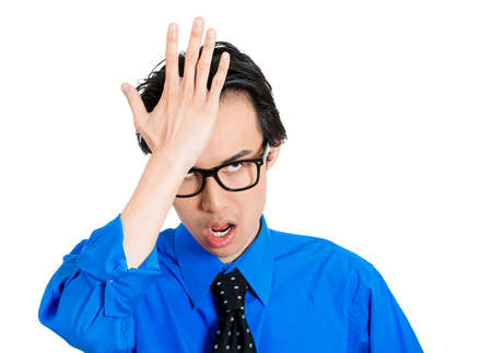blunder: Closeup portrait of goofy, funny face, nerdy man with black glasses slapping hand on head having a duh moment, isolated on white background. Negative emotion facial expression feelings, body language