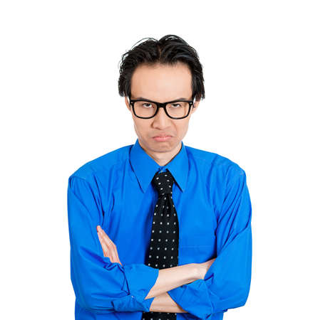 pissed: Closeup portrait of displeased, pissed off, angry, grumpy nerdy man with bad attitude, arms crossed looking at you, isolated on white background. Negative human emotions, facial expression, feeling