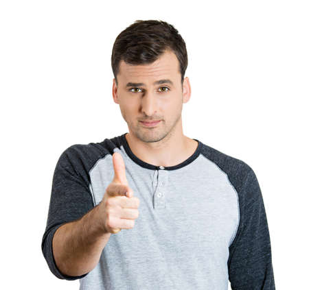 unprofessional: Closeup portrait of serious young handsome man pointing at you with index finger hand sign gesture, isolated on white . Negative human emotion facial expression feelings, symbols Stock Photo