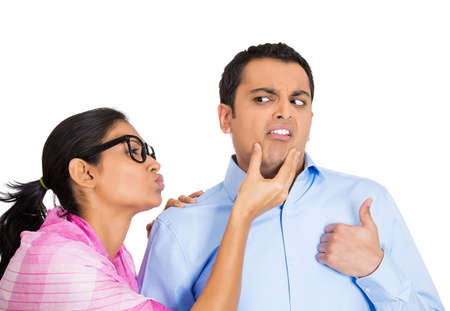 snobby: Closeup portrait of nerdy young woman with big black glasses trying to kiss snobby man who is grossed out, disgusted funny smirk on face, isolated white . Negative emotion facial expression