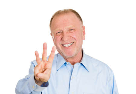 tertiary: Closeup portrait of senior mature man giving a three fingers sign gesture with hands, isolated on white . Positive emotion facial expression feeling,symbols