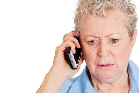 Closeup portrait of upset, sad, depressed, unhappy worried young woman talking on the phone, isolated on white . Negative human emotions, facial expressions, feelings, reaction. Bad news. photo