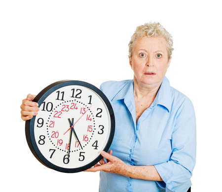 hectic life: Closeup portrait old business woman, funny looking elderly lady holding clock, stressed running out, pressured by lack of time, aging, late for meeting isolated on white . Negative emotions