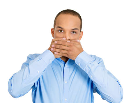 withhold: Closeup portrait of silent young man covering closed mouth observing. Speak no evil concept, isolated white . Negative human emotions, facial expressions signs, symbols. Media news coverup