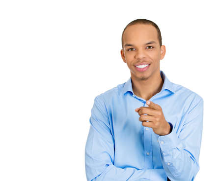 Closeup portrait of young smiling handsome man pointing at you with index finger, isolated on white . Positive human emotion facial expression feelings, signs, symbols, body language photo