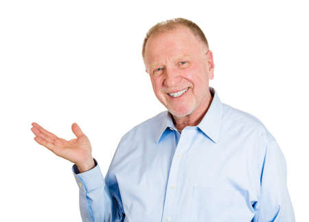 real leader: Closeup portrait of happy confident elderly smiling business man gesturing to space at left with palm up isolated on white . Positive human emotions, signs symbol, facial expression feelings