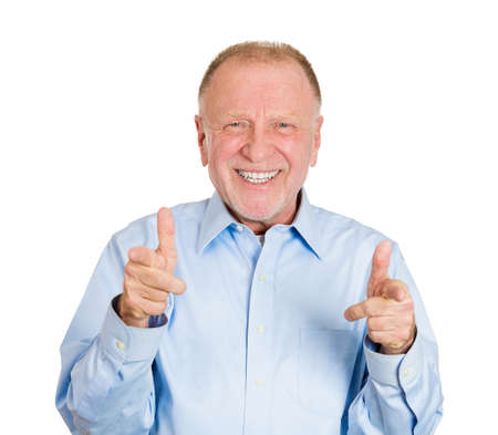 Closeup portrait of happy senior mature man with two hands guns sign gesture pointing at you camera, isolated on white . Positive human emotion facial expression feelings, signs and symbols photo