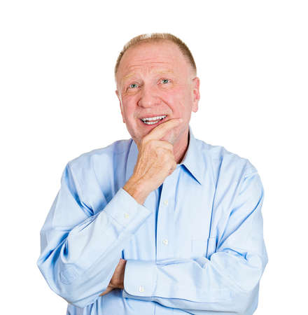 Closeup portrait of a senior mature man daydreaming about something that makes him happy, looking up, life memories of the past, isolated white background. Positive emotion facial expression feelings. Stock Photo