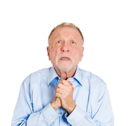 imploring: Closeup portrait of mature man praying, imploring, hands clasped, hoping for best, asking forgiveness, miracle isolated white . Positive human emotion facial expression feelings, reaction
