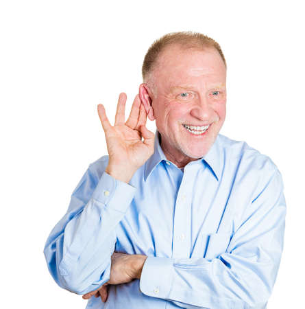 Closeup portrait of senior mature, nosy, shocked man hand to ear trying to secretly listen in on juicy gossip, conversation, news, and happy what he hears, privacy violation, isolated white  Stock Photo