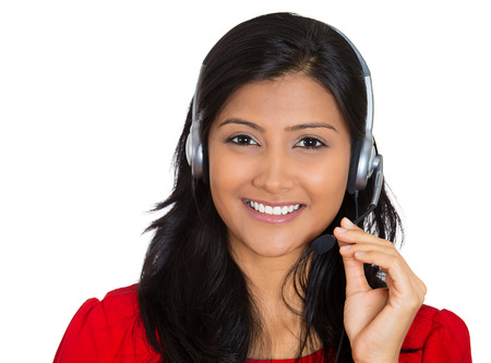 indian head: Closeup portrait of beautiful smiling adorable female customer representative business woman with phone headset chatting on line with customer isolated on white background. Human emotions, expressions
