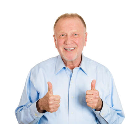 Closeup portrait of happy, confident, cheerful, smiling senior mature man showing thumbs up sign gesture, isolated on white background. Positive human emotions, facial expressions, feelings, attitude Stock Photo