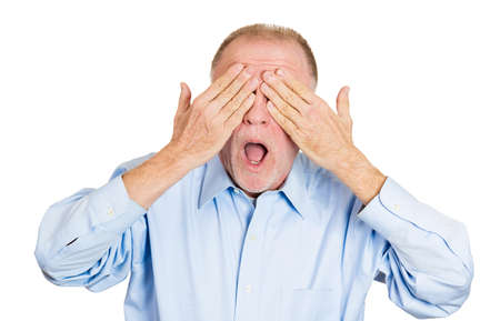 withhold: Closeup portrait of senior mature, coy man closing eyes with hands cant see and hiding mouth wide open, isolated on white background. See no evil concept. Negative emotion facial expression feelings