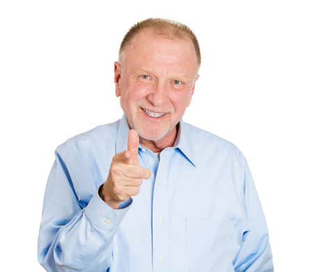Closeup portrait of happy senior mature man with one hands guns sign gesture pointing at you camera, isolated on white background. Positive human emotion facial expression feelings, signs and symbols photo