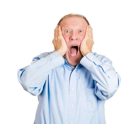 Closeup portrait of happy, senior mature man looking shocked surprised in full disbelief hands on cheek open mouth eyes, isolated on white background. Positive human emotion facial expression feeling photo