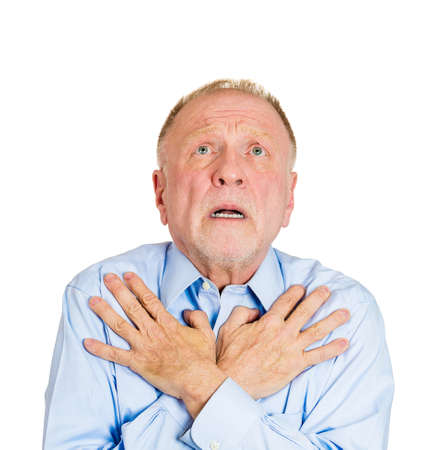 imploring: Closeup portrait of mature man praying, imploring, hands on chest, hoping for best, asking forgiveness, miracle isolated white background. Positive human emotion facial expression feelings reaction Stock Photo