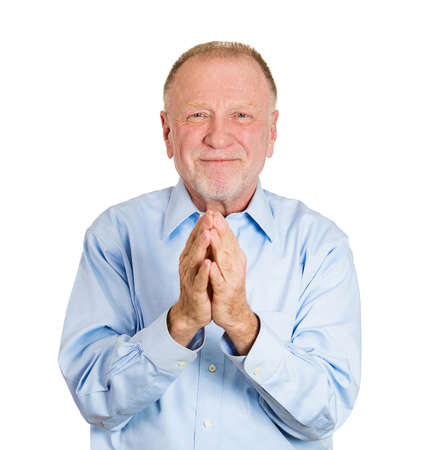 obliged: Closeup portrait of senior mature man, worker with hands clasped very grateful and thankful looking at you, camera, isolated on white background. Positive human emotion, facial expression