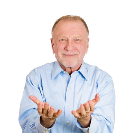free me: Closeup portrait of senior mature man, smiling, happy excited with raised up palms arms at you offering something, isolated over white background. Positive emotion facial expression signs symbols Stock Photo