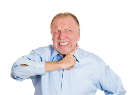 cut off head: Closeup portrait of senior mature man gesturing with hand to stop talking, cut it out, or that he will take your head off, isolated on white background. Negative emotion, facial expressions, feelings