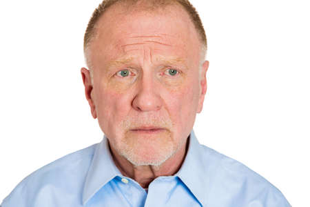 angry teacher: Closeup headshot portrait of pissed off, angry, grumpy business senior mature man with bad attitude, looking away, isolated on white background. Negative human emotions, facial expression, feeling Stock Photo
