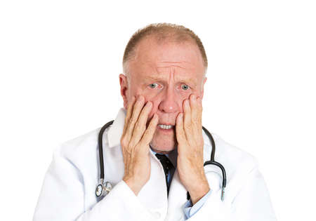 health care professional: Closeup portrait of senior mature health care professional, stressed, overwhelmed doctor, nurse, with stethoscope, isolated on white background. Negative human emotions, facial expression feelings.