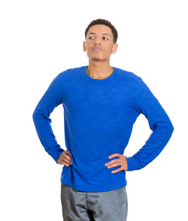 boastful: Closeup portrait of arrogant young man in blue shirt who thinks highly of himself, isolated on white  Stock Photo