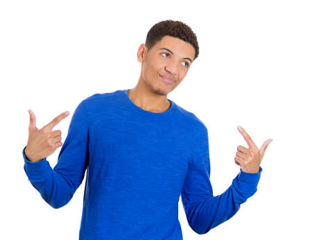 conceited: Closeup portrait of handsome young guy in blue shirt pointing to himself showing that he is the man, a stud, isolated on white  Stock Photo