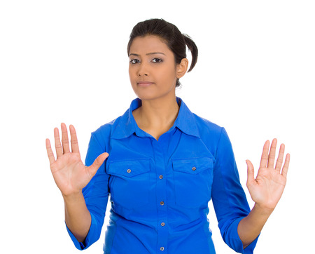 Closeup portrait of furious mad angry annoyed displeased young woman raising hands up to say no, stop right there, isolated on white  스톡 콘텐츠